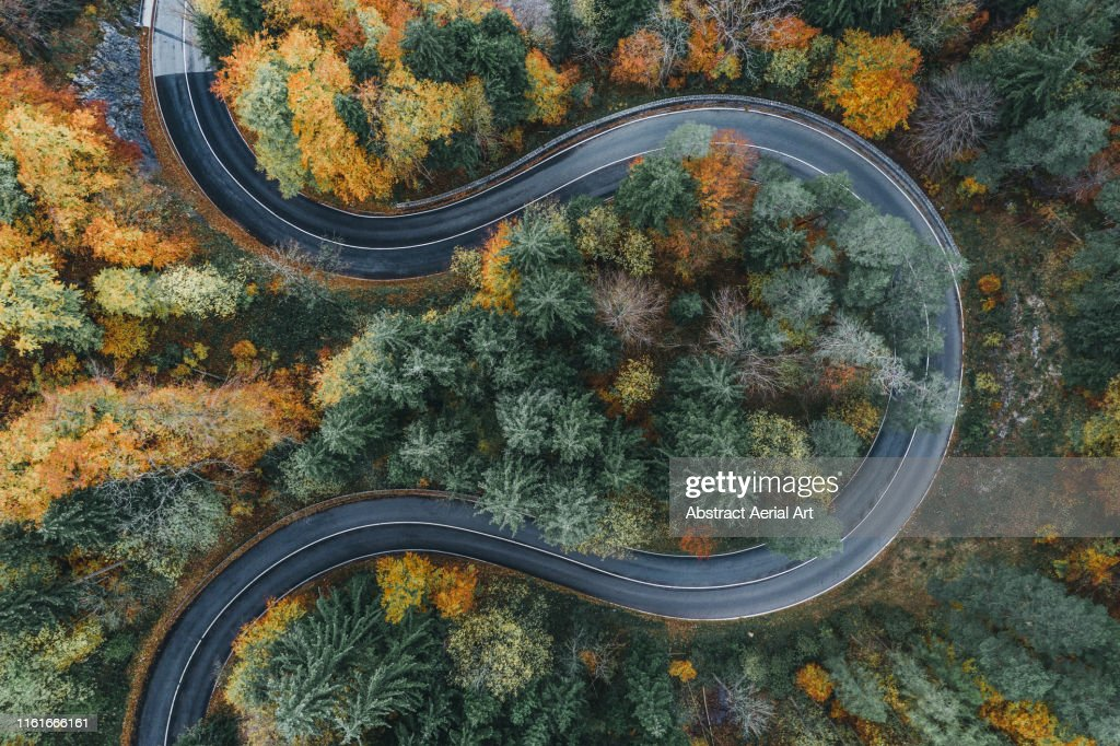Curved road during autumn in the Bavarian alps as seen from above, Germany : Stock-Foto