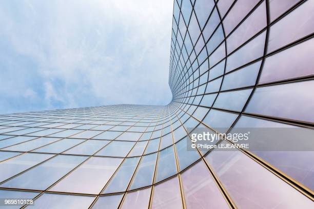 curved skyscraper against blue sky - skyscraper stock pictures, royalty-free photos & images