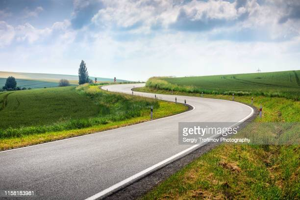 curved s-shape road in moravia fields - empty road stock pictures, royalty-free photos & images