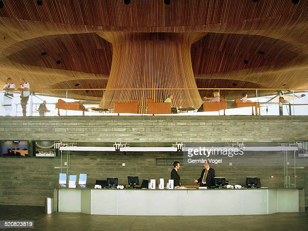 Curved wooden ceiling and reception desk at the then freshly inaugurated parliament of Wales in Cardiff or National Assembly of Wales