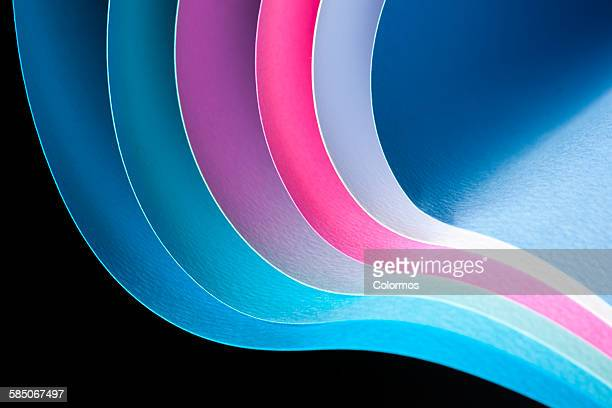 Curves of colored papers on black background