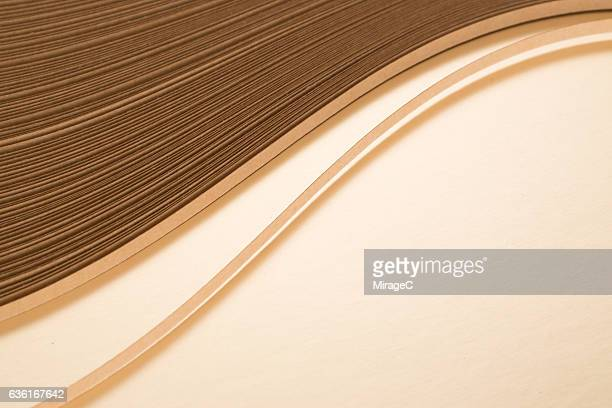 Curves of Gold Colored Paper Pile