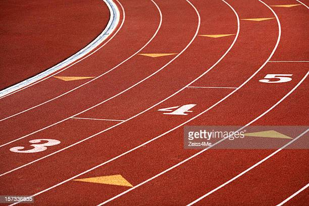 curving lanes of track - all weather running track stock pictures, royalty-free photos & images