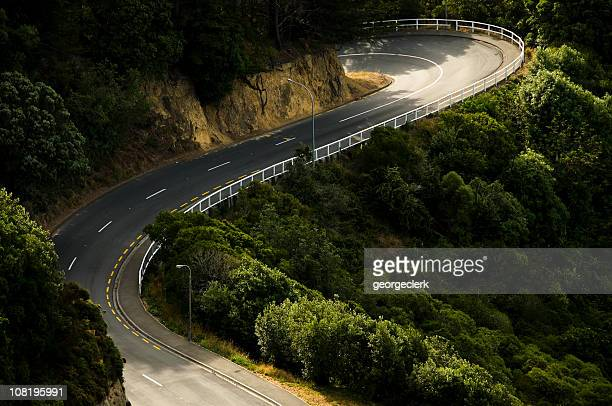 curving rural road - wellington new zealand stock photos and pictures