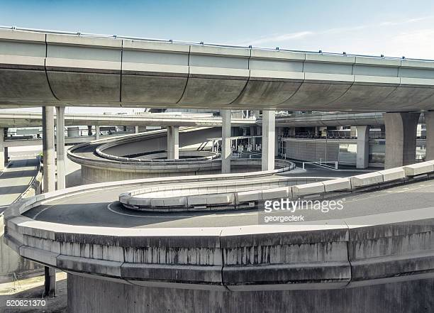 curving spiral access roads - interchange stock pictures, royalty-free photos & images