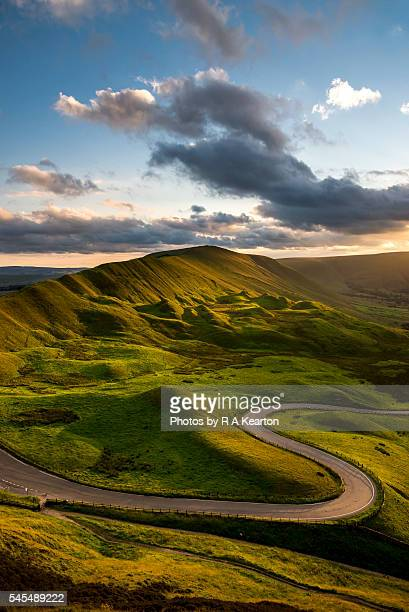 curvy road below rushup edge, derbyshire, england - peak district national park stock pictures, royalty-free photos & images