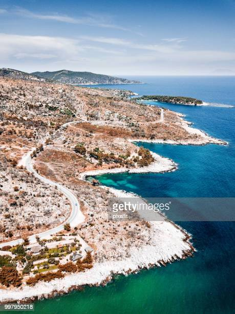 curvy road by rocky coastline on thassos island, greece - thasos stock photos and pictures