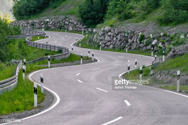 curvy road in the bavarian alps, germany, europe - mountain pass stock pictures, royalty-free photos & images