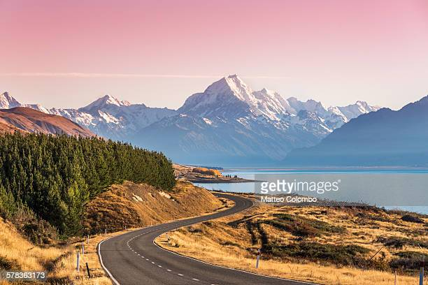 Curvy road leading to Mt Cook (Aoraki) at sunrise