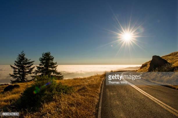 Curvy road overlooking Clouds