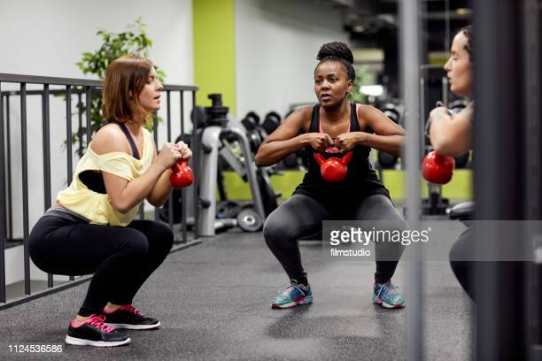 curvy women in the gym - curvy women stock pictures, royalty-free photos & images