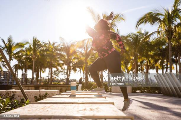 curvy young black woman exercising, having sport training in miami beach public park - plus size model stock pictures, royalty-free photos & images