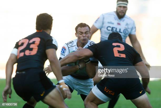 Curwin Bosch of Sharks is tackled by Agustin Creevy of Jaguares during a match between Jaguares v Sharks as part of Super Rugby Rd 10 at Jose...