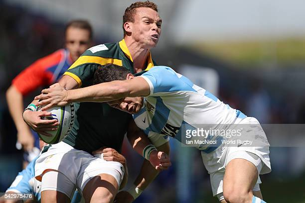Curwin Bosch of South Africa is tackled by Lautaro Bazan Velez of Argentina during the third place play off match between Argentina and South Africa...