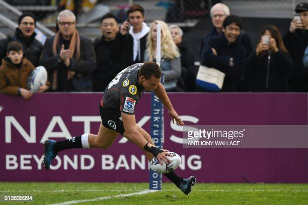 Curwin Bosch of South Africa's Sharks scores a try during the Natixis Cup rugby union match between France's Racing 92 and South Africa's Sharks in...