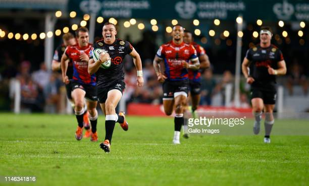 Curwin Bosch of the Cell C Sharks runs with the ball during the Super Rugby match between Cell C Sharks and Emirates Lions at Jonsson Kings Park...