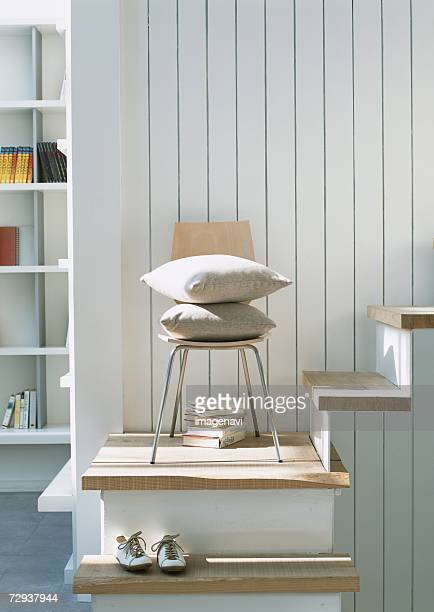 Cushion and chair on stair landing