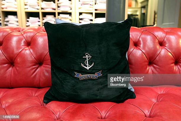 A cushion embroidered with a Gieves shipping anchor is seen inside the Gieves Hawkes store owned by Trinity Ltd on Saville Row in London UK on...