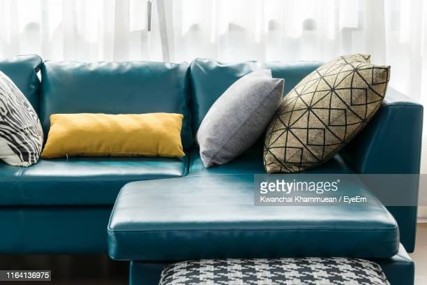 cushions and pillow on sofa at home - cushion stock photos and pictures