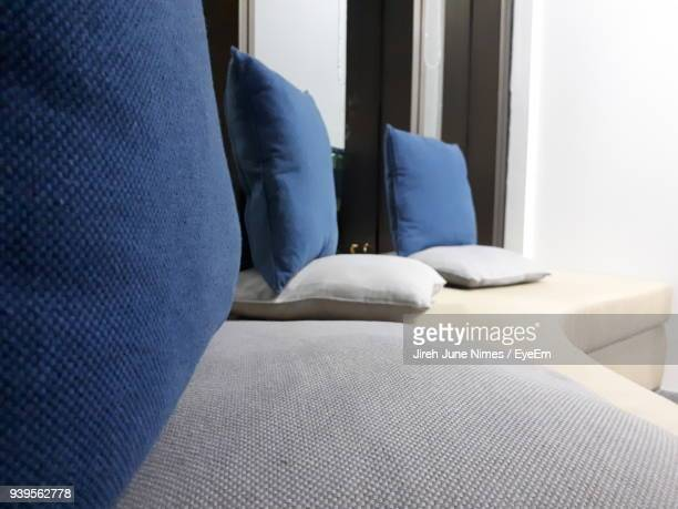 cushions arranged on sofa at home - cushion stock photos and pictures