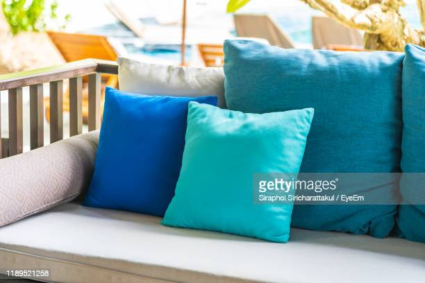 cushions arranged on sofa - pillow stock pictures, royalty-free photos & images