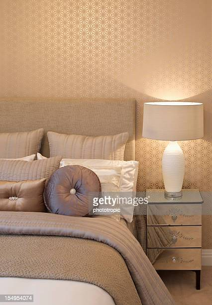 cushions, bed and bedside table