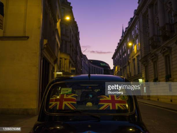 Cushions featuring a British Union flag also known as the Union Jack design sit on display in the back of a London Black Taxi Cab in the City of...