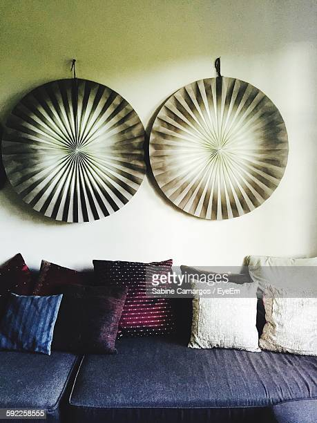 Cushions On Sofa Against Wall At Home