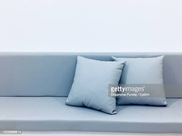 cushions on sofa at home - cushion stock photos and pictures