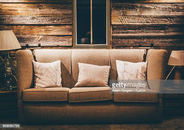 Cushions On Sofa In Living Room At Home