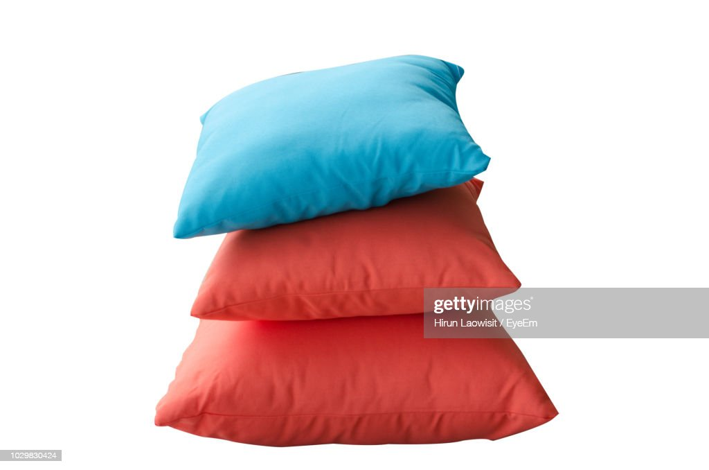 Cushions Stacked Against White Background : Stock Photo