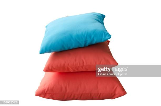 cushions stacked against white background - cushion stock photos and pictures