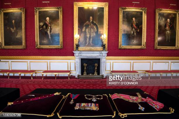 Cushions with insignia sewn into place of Britain's Prince Philip, Duke of Edinburgh are on view at St James's Palace in London on April 13, 2021. -...