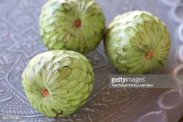 custard fruit on decorative metal tray, close up
