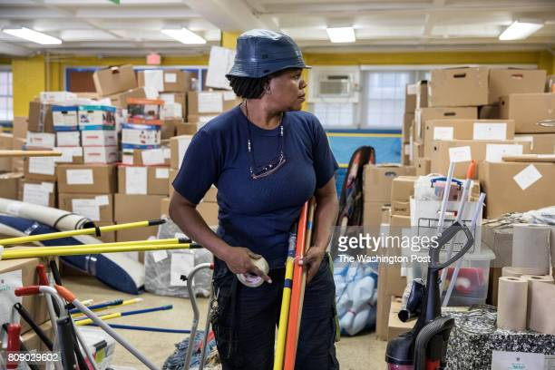 Custodial foreman Rachel Barnes packs up janitorial supplies at Kimball Elementary School June 21 in Washington DC Kimball Elementary is closing for...