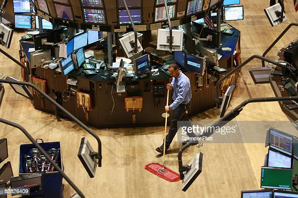 Custodian cleans up the floor of the New York Stock Exchange September 15, 2008 in New York City.In afternoon trading the Dow Jones Industrial...