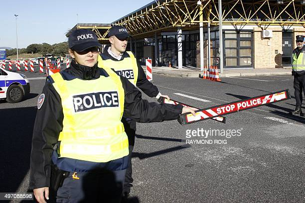 Custom and border police officers control vehicles at the FrenchSpanish border near Perthus on November 14 2015 European capitals reinforced security...