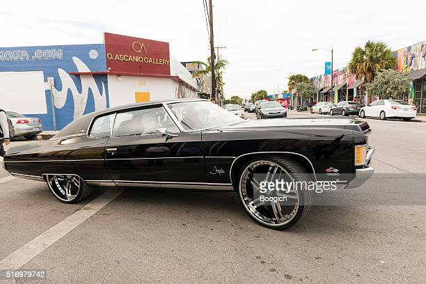 custom chevrolet impala car with drives through wynwood miami - chevrolet impala stock pictures, royalty-free photos & images