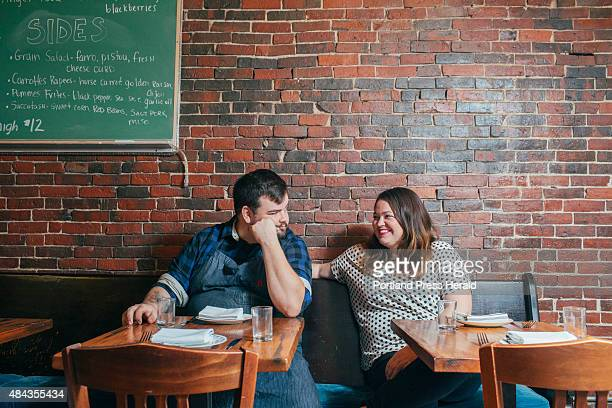 Custom Deluxe coowners Thomas Malz and Megan McVey sit in the dining area of the restaurant in Biddeford ME on Thursday July 30 2015