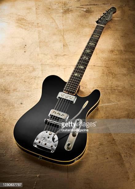 Custom Fender-style hybrid electric guitar built from a 1960s Epiphone Crestwood Custom, DeArmond Model 2000 pickups and a Fender Jaguar vibrato,...