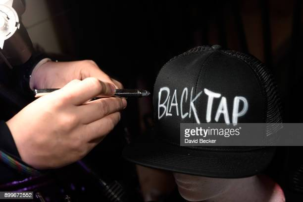 A custom hat is displayed during the grand opening of Black Tap Craft Burgers Beer at The Venetian Las Vegas on December 29 2017 in Las Vegas Nevada