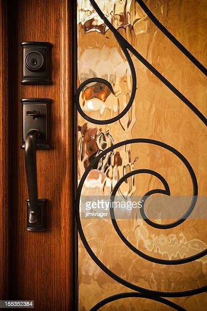 Custom home door with brass handle.