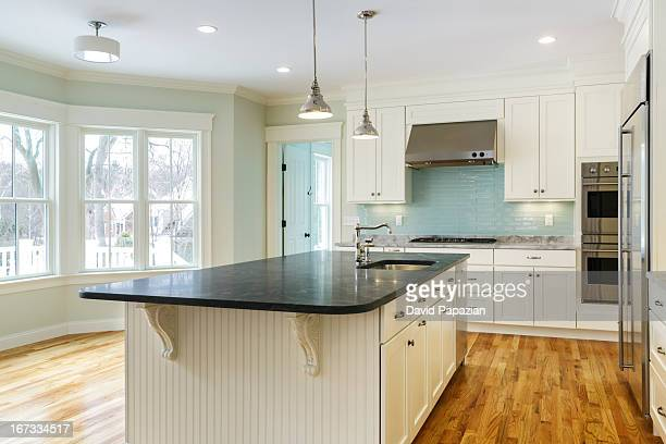 Custom home interior with view of kitchen