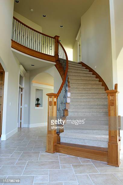 Custom Home Staircase with spiral wood trimming