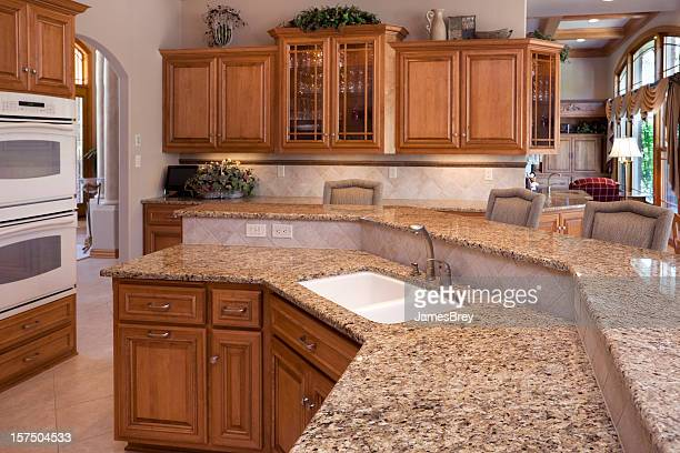 custom luxury eat-in kitchen with granite counters, oak cabinets - granite rock stock pictures, royalty-free photos & images