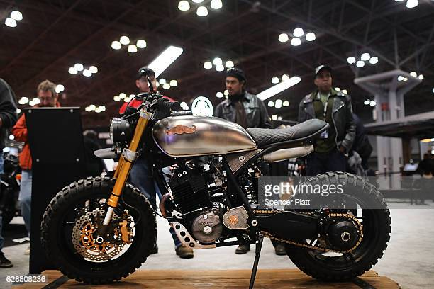 Custom motorcycles are displayed on the floor at the Progressive International Motorcycle Show at the Javits Center on December 9 2016 in New York...