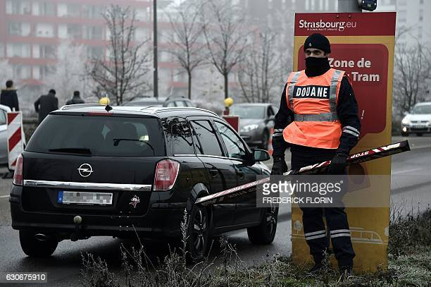 Custom officer control cars as they search for fireworks at the border between France and Germany in the eastern French city of Strasbourg on...