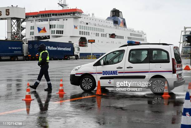 A custom officer looks at trucks on their way to Great Britain during a day of test in case of Brexit at the terminal Ferry in Calais northern France...