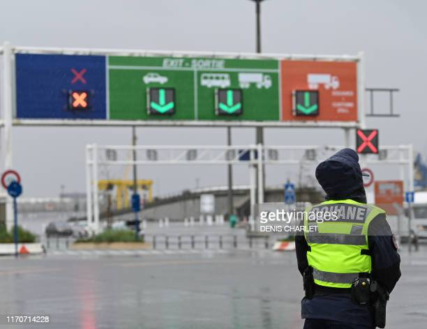 Custom officer stands during a day of test in case of Brexit at the terminal Ferry in Calais, northern France on September 24, 2019. - French customs...
