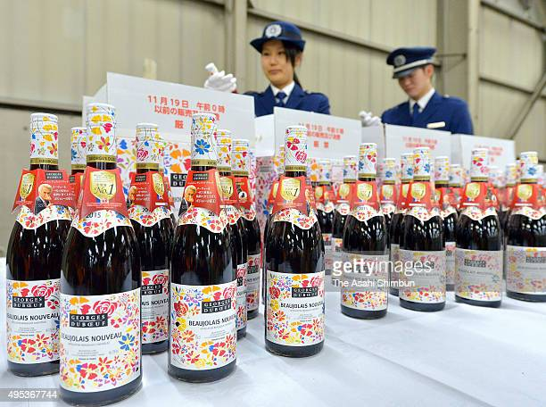 Custom officers inspect the bottles of Beaujolais Nouveau arriving at Kansai International Airport on October 31 2015 in Izumisano Osaka Japan